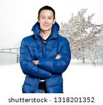 happy asian man in blue down... | Shutterstock . vector #1318201352