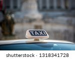taxi sign on the roof of a... | Shutterstock . vector #1318341728