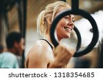 fit young woman in sportswear... | Shutterstock . vector #1318354685