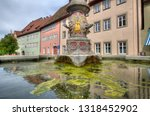fountain and historical houses... | Shutterstock . vector #1318452902