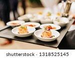 salmon tatrare in small plates  ...   Shutterstock . vector #1318525145