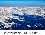Snow Capped Mountain Range ...