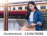 traveler young women using the... | Shutterstock . vector #1318678088