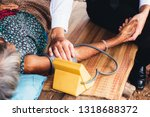 Small photo of Male Doctor listening heart beat and breathing of Elderly Woman with Stethoscope with First Aid Medical Box.Community Health and Development Hospital In Remote Areas Development Fund Concept.