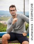handsome guy in shorts sitting... | Shutterstock . vector #1318942148