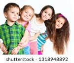 laughing small kids on a white... | Shutterstock . vector #1318948892