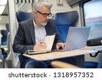 mature businessman working on... | Shutterstock . vector #1318957352