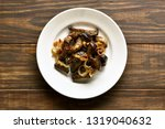fried beef liver with onion on...   Shutterstock . vector #1319040632