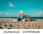 father and son having fun on... | Shutterstock . vector #1319058668