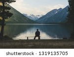 senior is seating alone on the... | Shutterstock . vector #1319135705