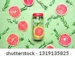 rosemary and pink grapefruit... | Shutterstock . vector #1319135825