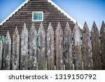 wooden fence in front of a... | Shutterstock . vector #1319150792