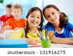 portrait of two diligent girls... | Shutterstock . vector #131916275