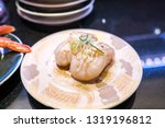 fresh sushi platter served in... | Shutterstock . vector #1319196812