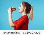 woman in red t shirt eats fast...   Shutterstock . vector #1319327228