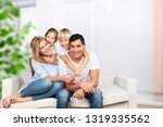 beautiful smiling family... | Shutterstock . vector #1319335562