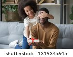 cute african kid daughter... | Shutterstock . vector #1319345645