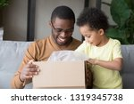 happy black father and little... | Shutterstock . vector #1319345738