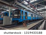 The subway train is repairing at workshop in railroad depot
