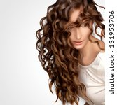 beautiful woman with curly long ... | Shutterstock . vector #131953706