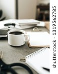 coffee cup on home office desk... | Shutterstock . vector #1319562785