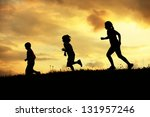 Active group of kids spending happy time on summer sunset at meadow - stock photo
