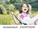 little child blond girl having... | Shutterstock . vector #1319574245