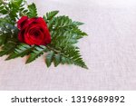 solitary red rose and greenery... | Shutterstock . vector #1319689892