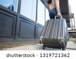 woman with travel trolley... | Shutterstock . vector #1319721362