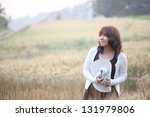 young smiling woman in field... | Shutterstock . vector #131979806