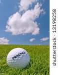 practice golf ball on grass bunker with blue sky background - stock photo