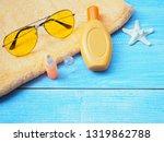 top view of sunbath accessories ... | Shutterstock . vector #1319862788