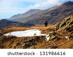 hiker on a high mountain field  ... | Shutterstock . vector #131986616