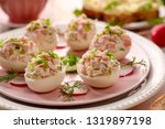 deviled eggs  stuffed eggs... | Shutterstock . vector #1319897198