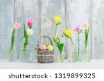 colorful flowers in glass... | Shutterstock . vector #1319899325