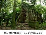 an old chapel being reclaimed... | Shutterstock . vector #1319901218
