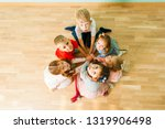 happy kids sitting close in a... | Shutterstock . vector #1319906498
