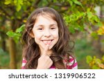 portrait of girl pointing with... | Shutterstock . vector #1319906522
