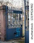 Small photo of QUATZENHEIM, FRANCE - FEB 20, 2019: swastika sprayed at the entrance of Jewish cemetery in Quatzenheim near Strasbourg
