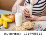 girl drinking organic rice milk ... | Shutterstock . vector #1319955818