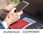 man holding phone in hand... | Shutterstock . vector #1319955845