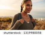 woman walking on a country path ... | Shutterstock . vector #1319980058