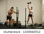 muscular build man doing sled... | Shutterstock . vector #1320060512