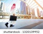 arab businessman walking in... | Shutterstock . vector #1320139952