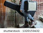 Street Musician Holding A Case...
