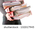 Woman In Grey Holding Stack Of...