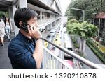 man talking by mobile phone on... | Shutterstock . vector #1320210878