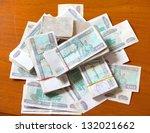 table full of money bills Kyat from Myanmar - stock photo
