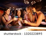 group of female friends... | Shutterstock . vector #1320223895