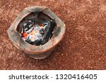 burning charcoal in the old... | Shutterstock . vector #1320416405
